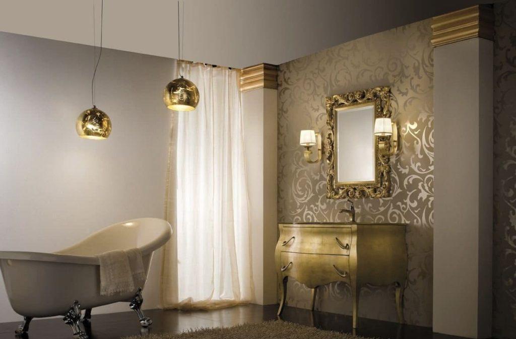 серый кафель в ванной с золотистой мебелью