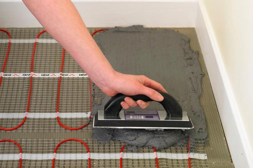 электрический теплый пол под плитку-укладка